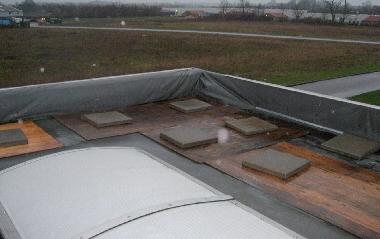 Ballast på fladt tag for at forhindre afrivning af tagmambran